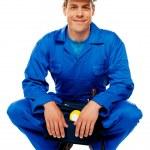sonriendo usando casco de seguridad hombre trabajador — Foto de Stock