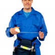 Male worker stretching measuring tape — Stock Photo