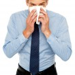 Young man having severe cold. Sneezing — Stock Photo #11885766