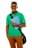 College student with sunglasses over his head — Stock Photo