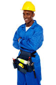 Smiling african worker posing with arms crossed — Stock Photo