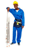 Smiling african worker resting hand on stepladder — Stock Photo