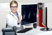 Experienced female physician holding x-ray — Stock Photo