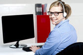 Portrait of cheerful customer support executive — Stock Photo