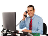 Businessman talking on phone, handling clients — Stock Photo