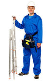 Repairman with a stepladder and tools bag — Stock Photo