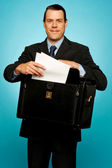 Male executive arranging paper works — Stock Photo
