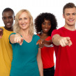 Team of smiling teenagers indicating at you — Stock Photo #12130727