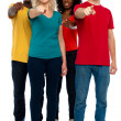 Stock Photo: Cheerful group of teenagers pointing at you