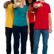 Cheerful group of teenagers pointing at you — Stock Photo