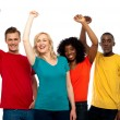 Excited teenager group posing with raised arms — Stock Photo