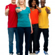 Happy young teens gesturing thumbs up — Stock Photo