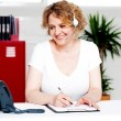 Cheerful customer support executive at work — Foto Stock
