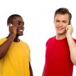 Two handsome men communicating on cellphone — Stock Photo