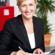 Female secretary writing on notepad — Stock Photo