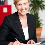 Female secretary writing on notepad — Stock Photo #12130980
