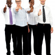 Stock Photo: Full length shot executives showing thumbs up
