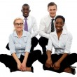 Four business colleagues sitting on floor — Stock Photo