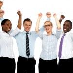 Business team of four celebrating success — Stock Photo