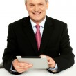 Handsome aged business male using tablet pc — Stock Photo