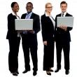 Stock Photo: Two business teams posing with laptop