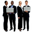 Foto Stock: Two business teams posing with laptop