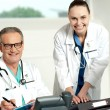 Stock Photo: Doctors team. Female assistant typing on keyboard