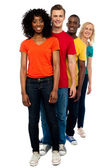 Line of casual friends dressed in colorful attires — Stock Photo