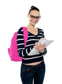 Beautiful smiling college student writing notes — Stock Photo