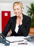 Customer support staff holding mic and communicating — Stock Photo