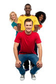Young standing behind semi seated guy — Stock Photo