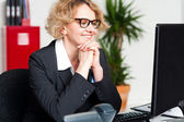 Relaxed portrait of beautiful aged corporate woman — Stock Photo