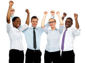 Business team of four celebrating success — Stock Photo