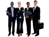 Happy smiling business team standing in a row — Stock Photo