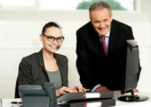Cheerful corporate at work in office — Stock Photo