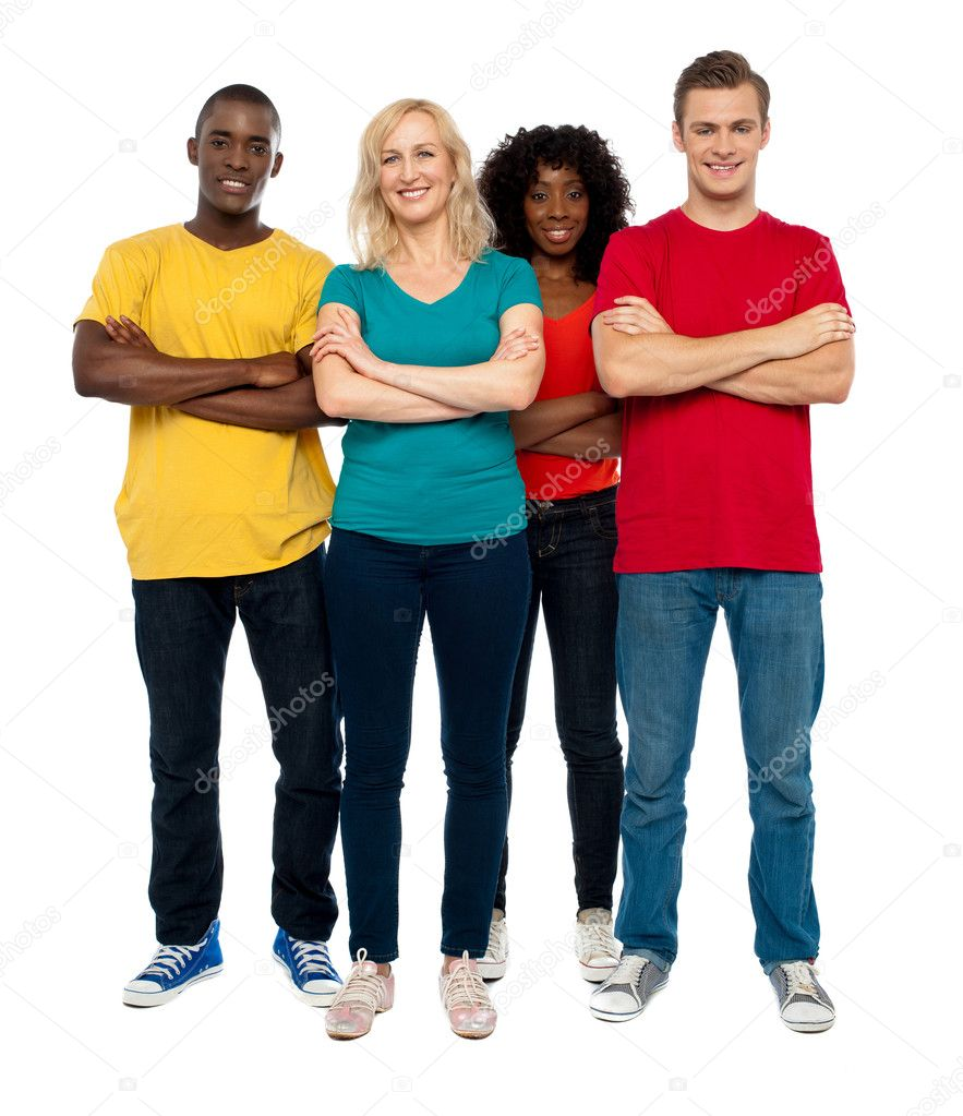 Team of young standing with crossed hands against white background  Stock Photo #12130745
