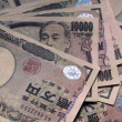 Pile of Japanese Yen bank notes - Stock Photo