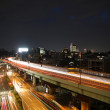 Long exposure image of cars racing over a highway in Tokyo, Japan — Stock Photo