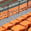 Rows of empty orange seats in a stadium — Stockfoto