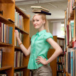 Female university student has fun in the library — Stock Photo #11540107