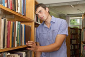 Depressed student standing at the library — Stock Photo