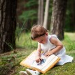 Little girl watching a family photo album — Stock Photo #11944579