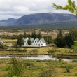 Stock Photo: Church and houses in Pingvellir Iceland