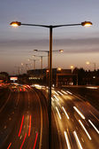 Traffic lights in motion blur at Night — Stock Photo
