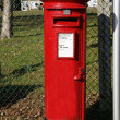 Traditional British red post box — Stock Photo