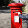 Traditional British red post box - Stock Photo