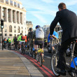 Bicycle commuters in London - Stock Photo