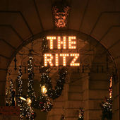 The Ritz hotel sign with Christmas decoration at night — Stock Photo