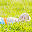 Royalty-Free Stock Photo: Little dreaming baby laying on the grass