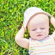 Little dreaming baby laying on the grass — Stock Photo